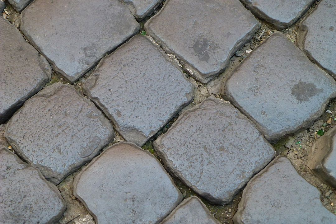 romes-cobbled-street-stones-worn-smooth